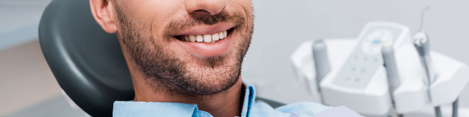 Patient smiling in dental clinic