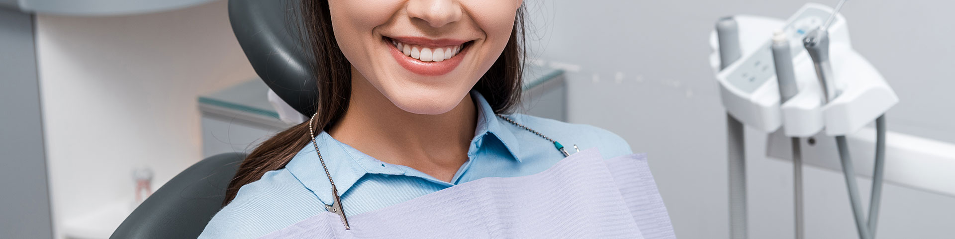Cheerful woman smiling in dental